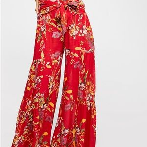 Super cute red Free People pants! NEVER WORN.